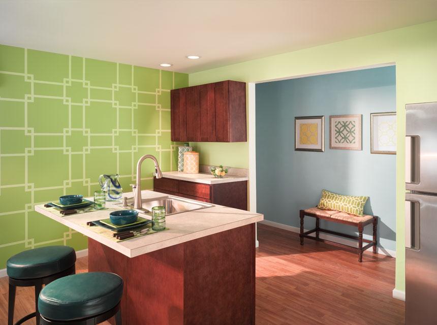 Pared de cocina decorada con entramado verde