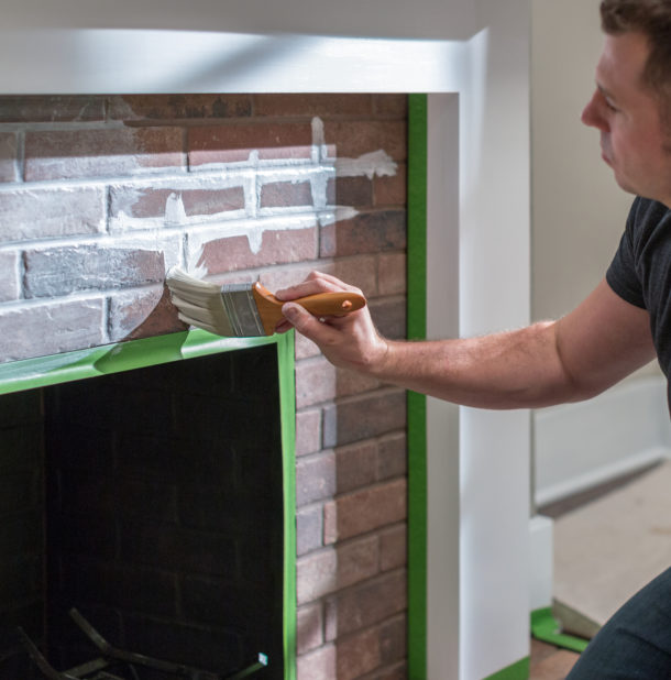 upgrade your brick fireplace with whitewash  image